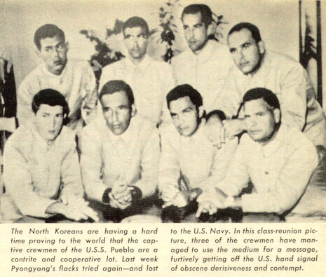 north_korea_propaganda_photograph_of_prisoners_of_the_uss_pueblo_with_the_hawaiian_good_luck_sign_1968